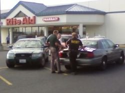 Police set up a perimeter outside the Rite-Aid store at Argonne and Mission in Spokane Valley.
