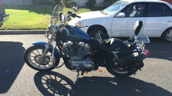 A Spokane woman was hospitalized with non life threatening injuries Friday after she crashed her motorcycle in her North Spokane neighborhood.