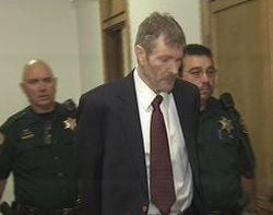 Kevin Coe walks into a Spokane County courtroom