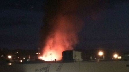 A large structure fire burning in Spokane Valley Monday night. Photo: Abby Clark