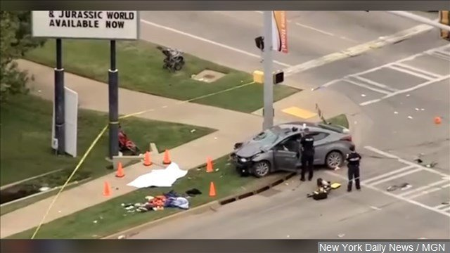"A prosecutor says it appears that a woman accused of driving her car into a homecoming parade near Oklahoma State University did so ""purposely."""