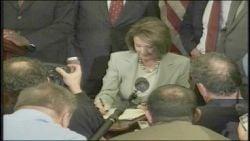Speaker of the House Nancy Pelosi (D-CA) signs legislation for the $700 billion bailout plan