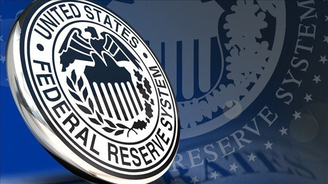 The Federal Reserve is keeping U.S. interest rates at record lows in the face of persistent threats from a weak international economy and excessively low inflation.