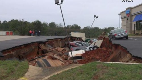 A Mississippi official says a Saturday night cave-in of a restaurant parking lot that swallowed 12 cars was not the result of a sinkhole. Photo: NBC