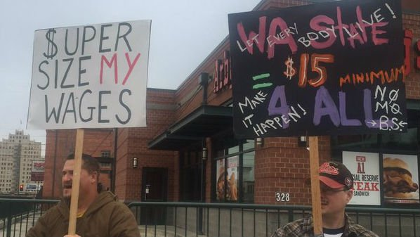 Workers rally in downtown Spokane for better living wages on Tuesday