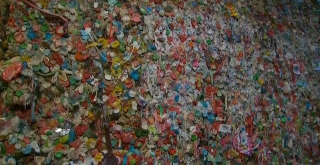 The wall is plastered with wads of gum in a kaleidoscope of colors, some stretched and pinched into messages, hearts and other designs. People also have used the gooey pieces to paste up pictures and other mementos.