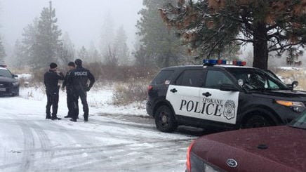 Police investigate after someone fell into a pond.