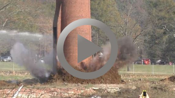 Scary moments after during the demolition of a 100-year-old smokestack in Pell City, Alabama