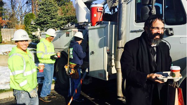 Rabbi Yisroel Hahn delivers coffee to linemen on Spokane's south hill