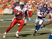 Vince young scrambles for a first down during the Pro Bowl (Courtesy: US Navy)