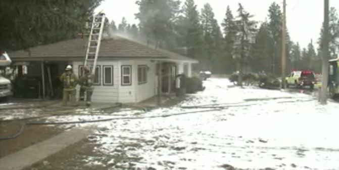 Firefighters from Spokane County Fire District #10 put out this house fire Tuesday afternoon