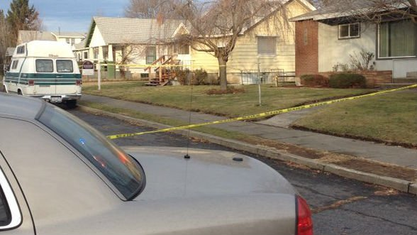 The scene on N. Howard Saturday afternoon after Dustin Mosher was found dead in a backyard