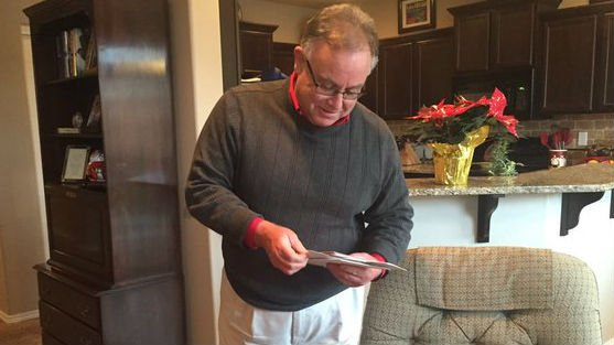 Mike Cressey looks through delayed mail.