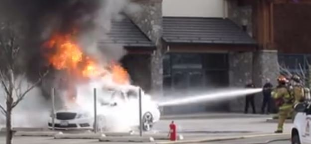 Firefighters extinguishing car fire in Post Falls. (PHOTO/VIDEO:  Donna Mason/Facebook)
