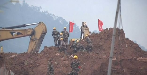 Rescuers have pulled a man out alive after he was buried for more than 60 hours in a massive landslide in southern China