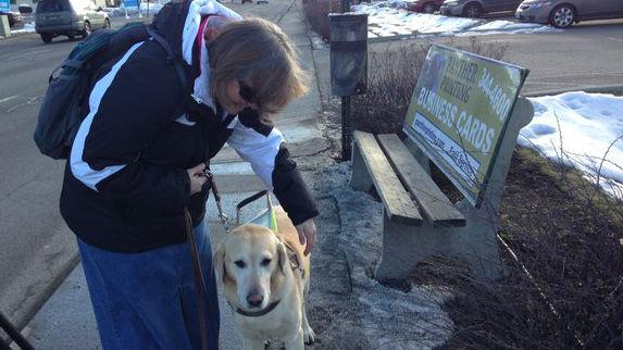 Alisa Alonge treks from the bus stop to her office in Spokane Valley everyday.
