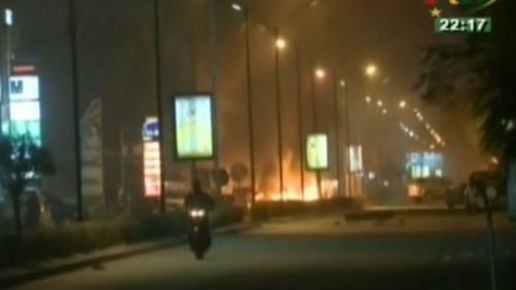 The blaze began after commandos trying to free an unknown number of hostages used explosives to enter the building. Photo: NBC