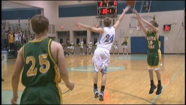 Shadle's Luke Jordan shoots over a Central Valley defender in the Highlanders' 62-50 win over the Bears (Photo: KHQ)