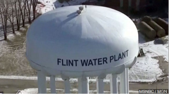 Michigan's attorney general will announce criminal charges Wednesday against two state regulators and a Flint employee, alleging wrongdoing related to the city's lead-tainted water crisis, according to government officials familiar with the investigation.