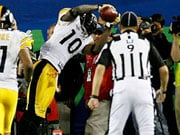 Santonio Holmes hauls in the winning touchdown against Arizona in Super Bowl XLIII
