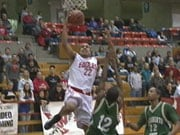 Eastern's Andy Genao skies over a Sacramento State defender for 2 of his 13 points (Photo: KHQ)
