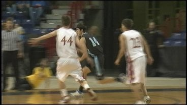 Central Valley's J.C. Agen drives around Titan defenders for two of his 17 points (PhotoL KHQ)