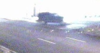 Surveillance picture of vehicle of interest in fatal hit and run
