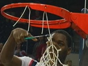 Jeremy Pargo cut down a net Saturday night after the Zags beat Pepperdine 92-58 (Photo: KHQ)