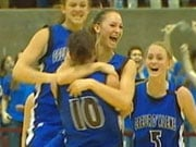 Girls on Coeur d'Alene's basketball team celebrate after winning their second-straight state title