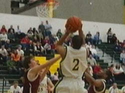 Shadle's Anthony Brown leaps over a host of defenders