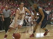 WSU's Taylor Rochestie drives around an Arizona defender.  The Cougs beat the Wildcats 69-53 (Photo: KHQ)