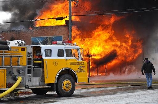 Firefighters battle a massive fire in Whitehall, Montana Friday. Courtesy: Danny Pecka