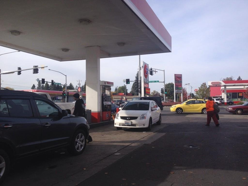 "Three gas stations in one intersection are competing to have the lowest prices. The locals have dubbed them ""gas wars,"" and customers seemed excited about gas under $3 per gallon."