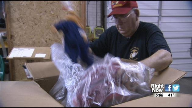 Pat Rowand sorts through Toys for Tots donations.